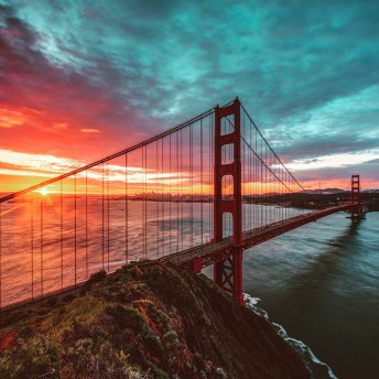 The Golden Gate Bridge opened in 1937. Sunrise photo by Bruce Getty. Tweeted by the US Department of the Interior, 5/27/16.