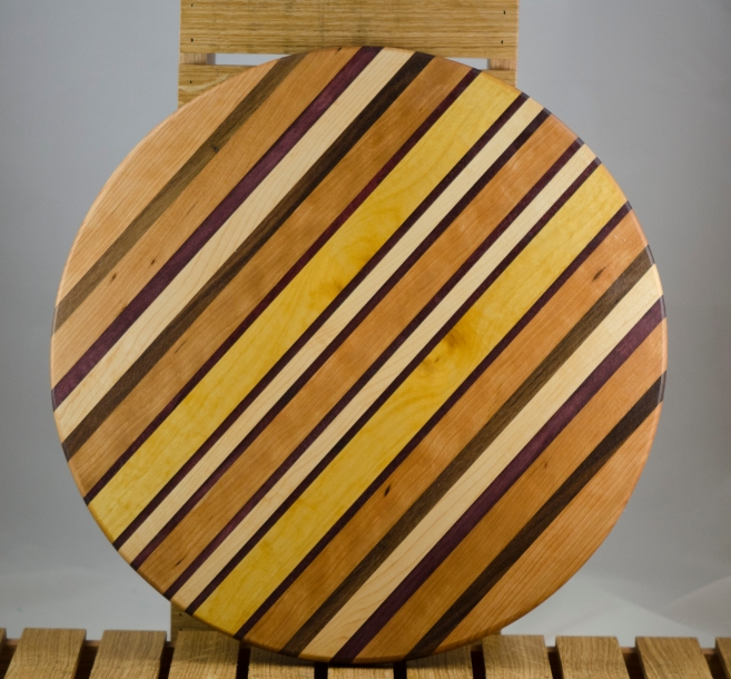 "Lazy Susan 16 - 020. Black Walnut, Cherry, Hard Maple, Purpleheart & Yellowheart. 17"" diameter."