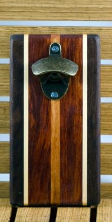 "Magic Bottle Opener 16 - 012. Wall mount. Black Walnut, Hard Maple, Bloodwood & Cherry. Approximately 5"" x 10"" x 3/4""."