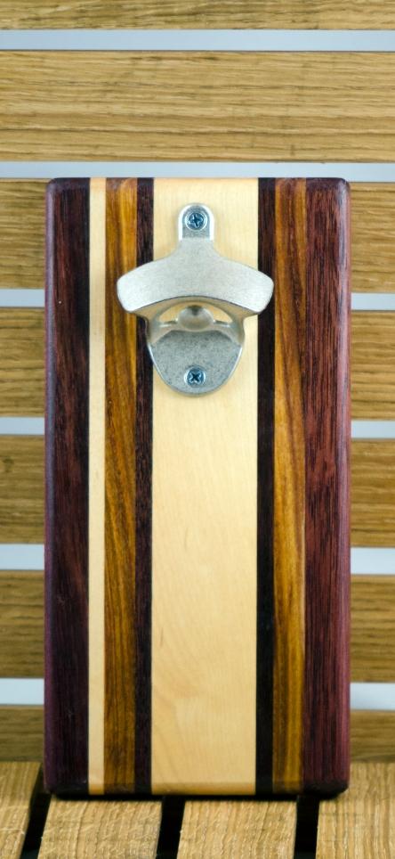 """Magic Bottle Opener 16 - 082. Wall mount. Purpleheart, Hard Maple, Canarywood & Black Walnut. Approximately 5"""" x 10"""" x 3/4""""."""