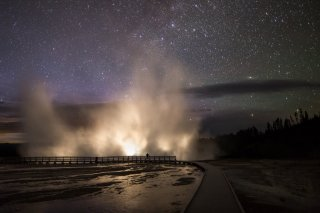 Car headlights, Excelsior Geyser & starry skies create an otherworldly image in Wyoming's Yellowstone National Park. Tweeted by the US Department of the Interior, 8/5/16.