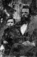 Alban Boring holding his son Norman Ernest Boring. Circa 1878.