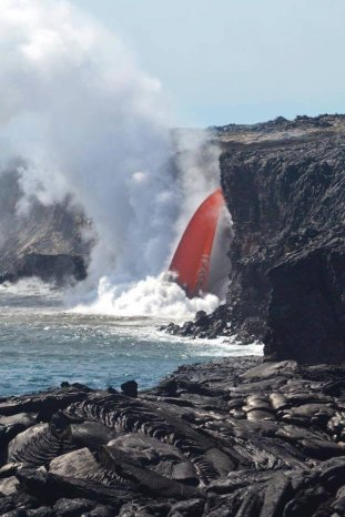 "A so-called ""firehose"" of lava pouring into the ocean at Hawaii Volcanoes National Park. Tweeted by the US Department of the Interior, 1/30/17."