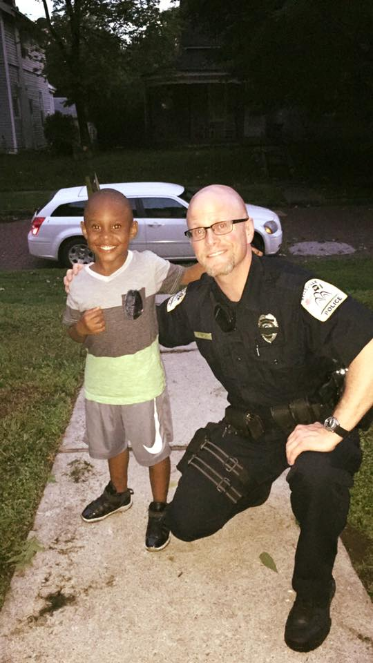"Paul Anderson, being a good cop on July 13, had these words, ""I made a new friend today! He said he wants me to be a police officer when he grows up, so of course he got an Honorary Police Badge! He was so happy! ""We may not mean something to everyone in the whole world, but some days we can mean the whole world to one person."""