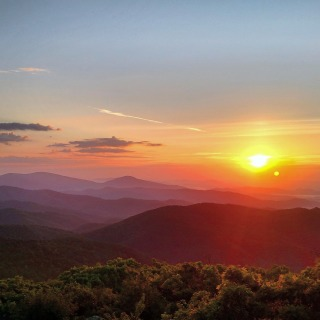 "Spectacular sunrises are a fantastic way to start an adventure in Shenandoah National Park in Virginia. Photographer Elliott Cliborne captured this brilliant photo at the top of Mary's Rock, where a 3.7-round trip hike along the Appalachian Trail leads to expansive views. Of the experience, says Cliborne: ""It was by far the best sunrise I experienced in over 400 miles of hiking last summer."" Photo courtesy of Elliott Cliborne. Posted on Tumblr by the US Department of the Interior, 6/21/16."