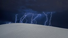 Lightning rips through the sky over White Sands National Monument in New Mexico. Here, great wave-like dunes of gypsum sand have engulfed 275 square miles of desert, creating the world's largest gypsum dunefield. Photo by Donald Palansky. Published on Tumblr by the US Department of the Interior, 7/22/16.