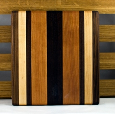 "Cheese Board 16 - 031. Black Walnut, Hard Maple & Cherry. 9"" x 12"" x 7/8""."