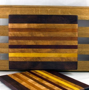 "Cheese Board 16 - 046. Purpleheart, Birds Eye Maple, Goncalo Alves, Jatoba, Bloodwood & Yellowheart. 9"" x 11"" x 3/4""."