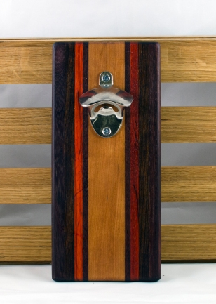 "Magic Bottle Opener 16 - 110. Single Magic. Padauk, Purpleheart & Cherry. 5"" x 10"" x 3/4""."