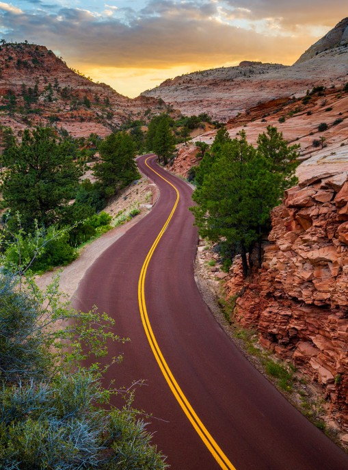 As you enter Zion National Park from the east, Mt. Carmel Highway offers spectacular views and ever changing landscapes as you zig-zag your way down into the park's canyon. Ian Barin captured this pic from above the winding road at sunset this past June. Photo by of Ian Barin. Tweeted by the US Department of the Interior, 9/21/16.