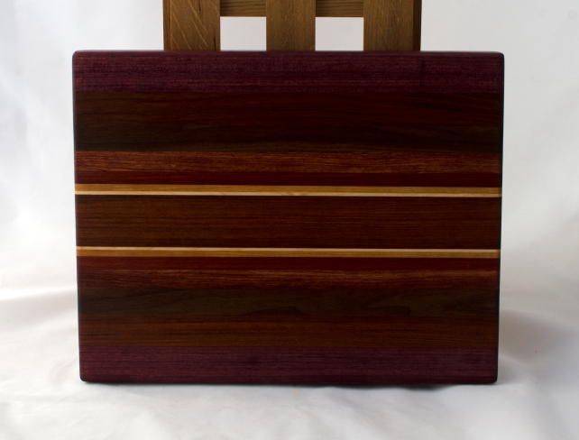"Cutting Board 16 - Edge 019. Purpleheart, Jatoba, Bloodwood, Bubinga, Padauk, Cherry & Hard Maple. 12"" x 16"" x 1-1/8""."