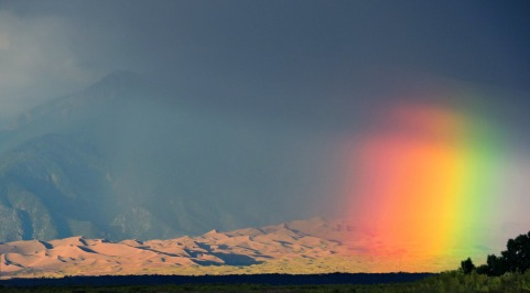 "In this rare sight, a rainbow (some call it a ""blob-bow"") brightens the dunes following an afternoon storm at Great Sand Dunes National Park and Preserve in Colorado. Summer thunderstorms at the park are common and bring cool winds, heavy rain and lightning. When storms approach, be sure to come down off the dunes, as lightning often strikes the dunefield. The electrical current fuses or melts sand particles together, resulting in a ""fulgurite"" (Latin for lightning rock). Photo by Patrick Myers, National Park Service. Posted on Tumblr by the US Department of the Interior, 9/14/16."