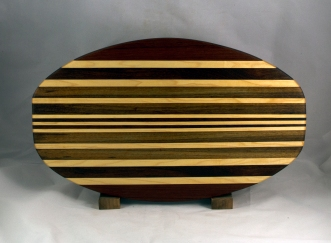 "Cheese & Cracker Server 16 - 14. Purpleheart, Hard Maple, Black Walnut & African Teak. 12"" x 19"" x 1-1/4""."