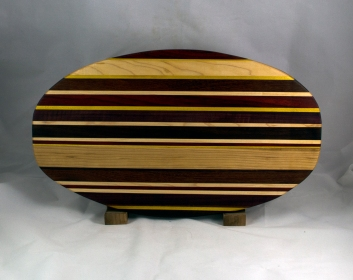 "Cheese & Cracker Server 16 - 16. Padauk, Yellowheart, Hard Maple, Black Walnut, Bloodwood, Purpleheart & Bubinga. Chaos Board. 12"" x 19"" x 1-1/4""."