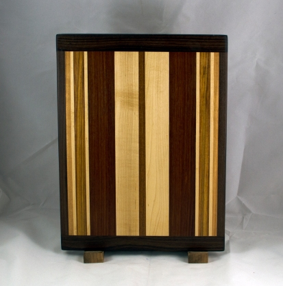 "Cutting Board 16 - Edge 020. Black Walnut, Cherry, Hard Maple, Canarywood & Jatoba. Bread Board Ends, Edge Grain. 12"" x 16"" x 3/4""."
