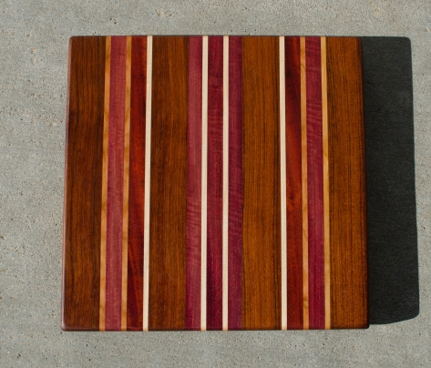 "Cutting Board 16 - Edge 029. Jatoba, Cherry, Bubinga, Bloodwood, Purpleheart & Hard Maple. Edge grain. 15"" x 15"" x 1-1/8""."