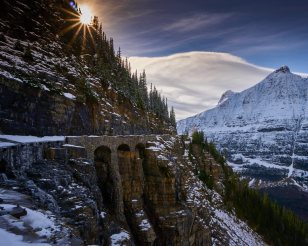 Much of the Going-to-the-Sun Road at Glacier National Park in Montana is closed to vehicles for the winter. A fall snow storm dusted the mountains with white and brought silence to this recently bustling road. Accessible only by bike and on foot, visitors will have to work harder for these amazing mountains views now. Photo by Steve Muller. Posted on Tumblr by the US Department of the Interior, 11/13/16.