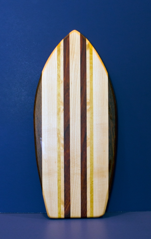 "Small Surfboard 16 - 22. Black Walnut, Hard Maple & Yellowheart. 7"" x 16"" x 3/4""."