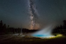 """Photographer Michael Sprill wanted to capture the Milky Way over the amazing landscape of Yellowstone National Park in Wyoming. He used a long exposure to capture the night sky and a flashlight to shine on Silex Spring, spotlighting the geothermal pool. He was very excited about the results, """"The steam coming off the water really makes the photo look magical!"""" Photo by Michael Sprill. Posted on Tumblr by the US Department of the Interior, 11/20/16."""