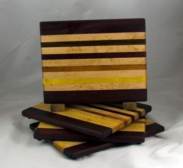 "Cheese Board 16 - 054. Purpleheart, Birdseye Maple, Jatoba, Goncalo Alves, Padauk & Yellowheart. 8"" x 11"" x 3/4""."