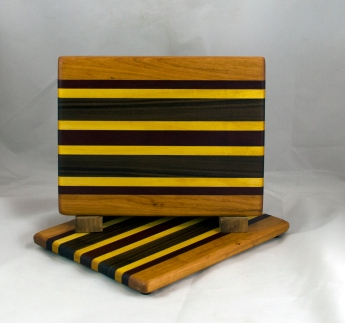 "Cheese Board 16 - 061. Cherry, Padauk, Yellowheart & Black Walnut. 8"" x 11"" x 3/4""."