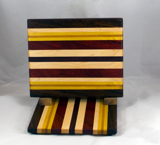 "Cheese Board 16 - 062. Black Walnut, Hard Maple, Yellowheart, Cherry & Padauk. 8"" x 11"" x 3/4""."