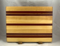 "Cutting Board 16 - Edge 030. Hard Maple, Bloodwood, Purpleheart & Bubinga. Edge Grain. 14"" x 18"" x 1-1/4""."