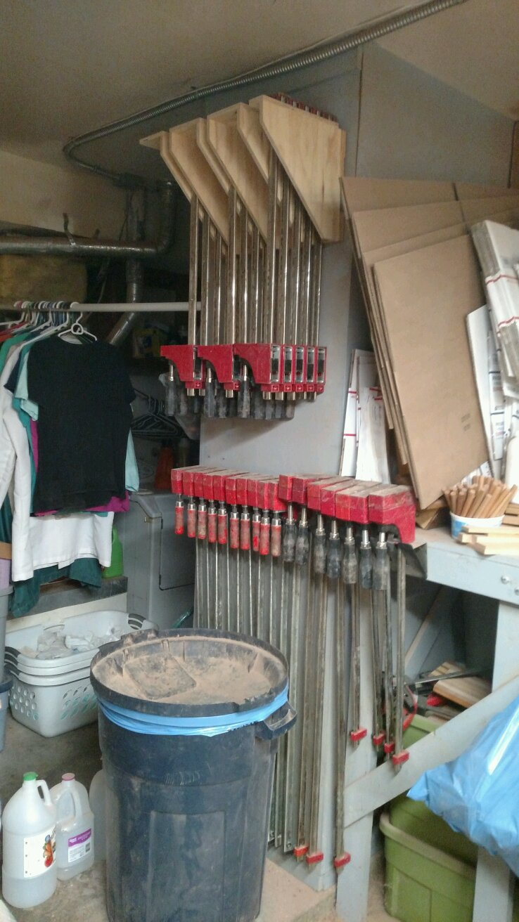 32 clamps properly stored, with a guest appearance by the trash can and boxes waiting to ship stuff. Such is life in a small shop.