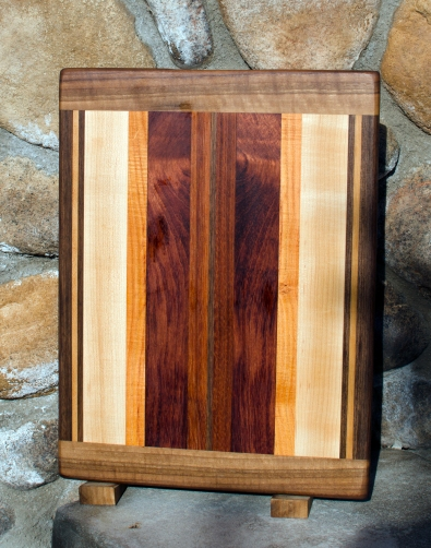 "Cutting Board 17 -106. Black Walnut, Cherry, Hard Maple, Honey Locust, Bubinga & Jatoba. Edge Grain with Bread Board Ends. 12"" x 16"" x 3/4""."