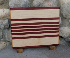 "Purpleheart & Hard Maple. Edge grain. 9"" x 11"" x 3/4""."