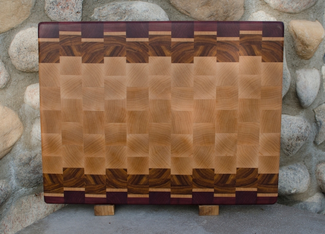 "Engraved 16 - 46. Purpleheart, Hard Maple & Canarywood. End grain. 14"" x 18"" x 1-1/2""."