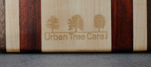Detail of engraving on Urban Tree Care's Bread Board.
