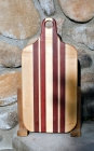 "Bread Board 17 - 501. Hard Maple & Bloodwood. This is an undersized bread board; most are 20"" long. Since this has a handle, it's not really a small board. According to me! 8"" x 16"" x 1""."