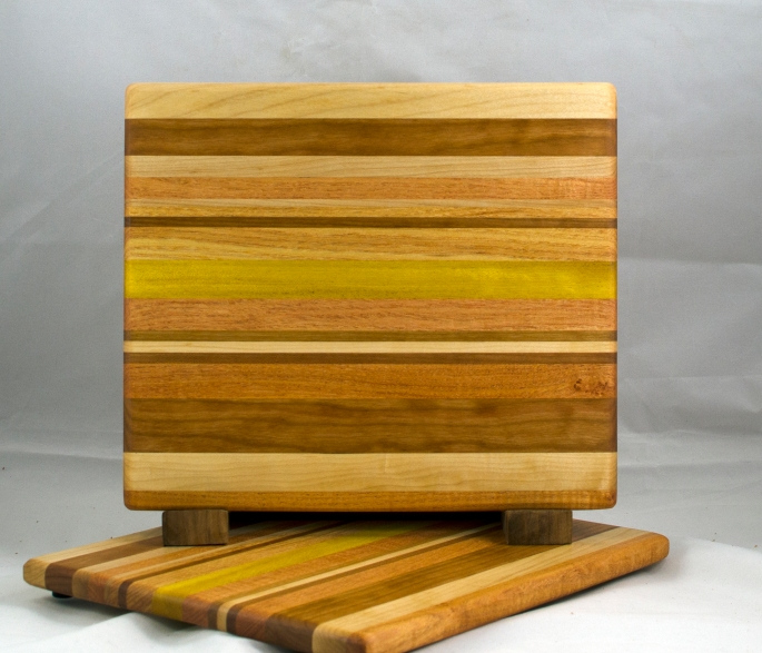 "Cheese Board 17 - 316. Hard Maple, Cherry, Honey Locust & Yellowheart. 10"" x 11-1/2"" x 1/2""."