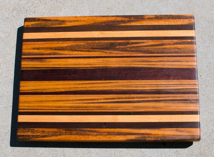 "Cutting Board 17 - 110. Goncalo Alves, Black Walnut, Honey Locust, Cherry & Jarrah. Edge Grain. 17"" x 21"" x 1-1/2""."