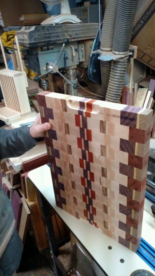 After the finger hold is routed, then I smooth all 12 edges of the board.