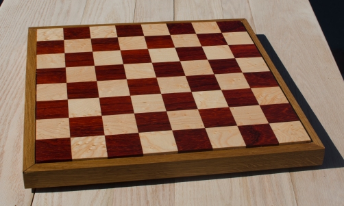"Chess 17 - 301. Padauk & Birds Eye Maple, proud of the White Oak frame. 18"" x 18"" x 1-1/2"". Sold in its first showing."
