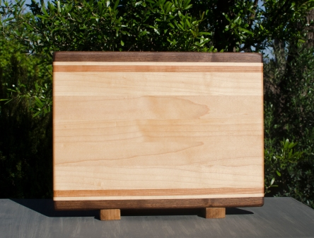 "Cutting Board 17 - 112. Black Walnut, Hard Maple & Cherry. 12"" x 16"" x 1-1/4""."