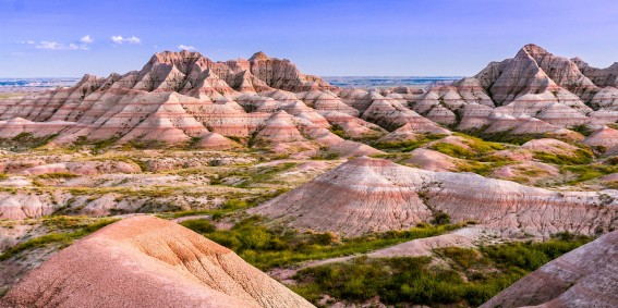 National parks preserve some of the most unique landscapes in America. Visitors to Badlands National Park in South Dakota are often shocked at the sudden appearance of these colorful formations rising out of the surrounding green plains. The rock formations and amazing fossil beds give us important evidence of the dramatic natural history of the area. Just another reason why national parks are great outdoor classrooms! Photo by Andreas Eckert. Posted on Tumblr by the US Department of the Interior, 4/19/17.