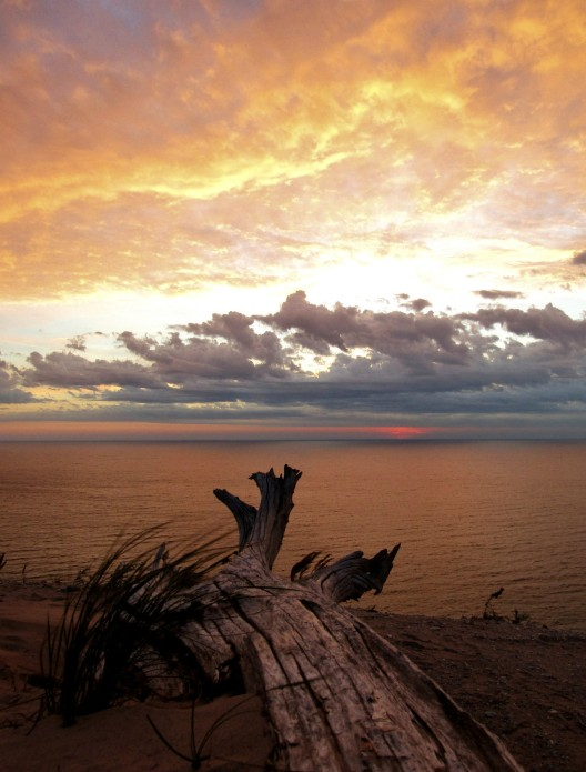 Perched on bluffs 400 feet above Lake Michigan, Sleeping Bear Dunes National Lakeshore in Michigan is a great place for lake vistas and sunset viewing. With 65 miles of shoreline and numerous inland lakes and streams, the park is perfect for lovers of aquatic fun. Photo by Ben Wynsma. Posted on Tumblr by the US Department of the Interior, 7/19/17.