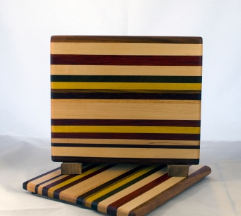 "Cheese Board 17 - 333. Chaos board. Black Walnut, Hard Maple, Padauk, Canarywood, Yellowheart, Honey Locust & Bloodwood. 8"" x 11"" x 5/8""."