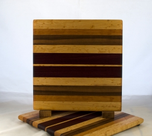 "Cheese Board 17 - 338. Birds Eye Maple, Cherry, Black Walnut, Yellowheart & Purpleheart. 10"" x 11"" x 5/8""."