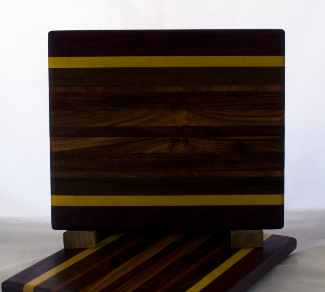 "Cheese Board 17 - 339. Purpleheart, Yellowheart, Canarywood & Bubinga. 8"" x 11"" x 5/8""."
