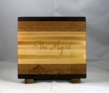 """Engraved 17 - 023. Black Walnut, Cherry & Hard Maple. Engraving styled after the """"save the date"""" received for their wedding."""