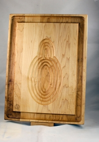 Carving Board - the poultry side. The graduated ribs of the oval are perfect to hold the fowl in place as you carve.