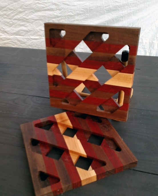 "Trivet 17 - 05. Black Walnut, Padauk and Hard Maple. 8.5"" x 8.5"" x .75""."