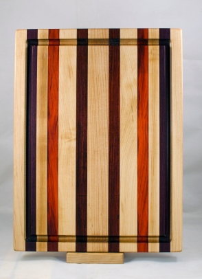 "Cutting Board 17 - 138. Hard Maple, Jatoba, Padauk & Bloodwood. Edge grain, Juice groove. 12"" x 16"" x 1-1/8""."