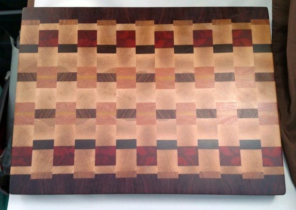 "Cutting Board 17 - 438. Purpleheart, Cherry, Hard Maple, Padauk, Jatoba, Honey Locust, Pau Ferro & Yellowheart. End Grain. 16-1/2"" x 21-1/2"" x 1-1/2"". Sold in its first showing."