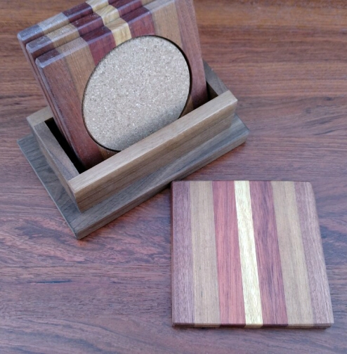 Coasters 18 - 05. Jatoba, Black Walnut, Bloodwood, Cherry & Cork. Shown with Black Walnut holder.