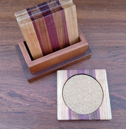 Coasters 18 - 08. Cherry, Purpleheart, Jatoba & Cork. Shown with Jatoba holder.
